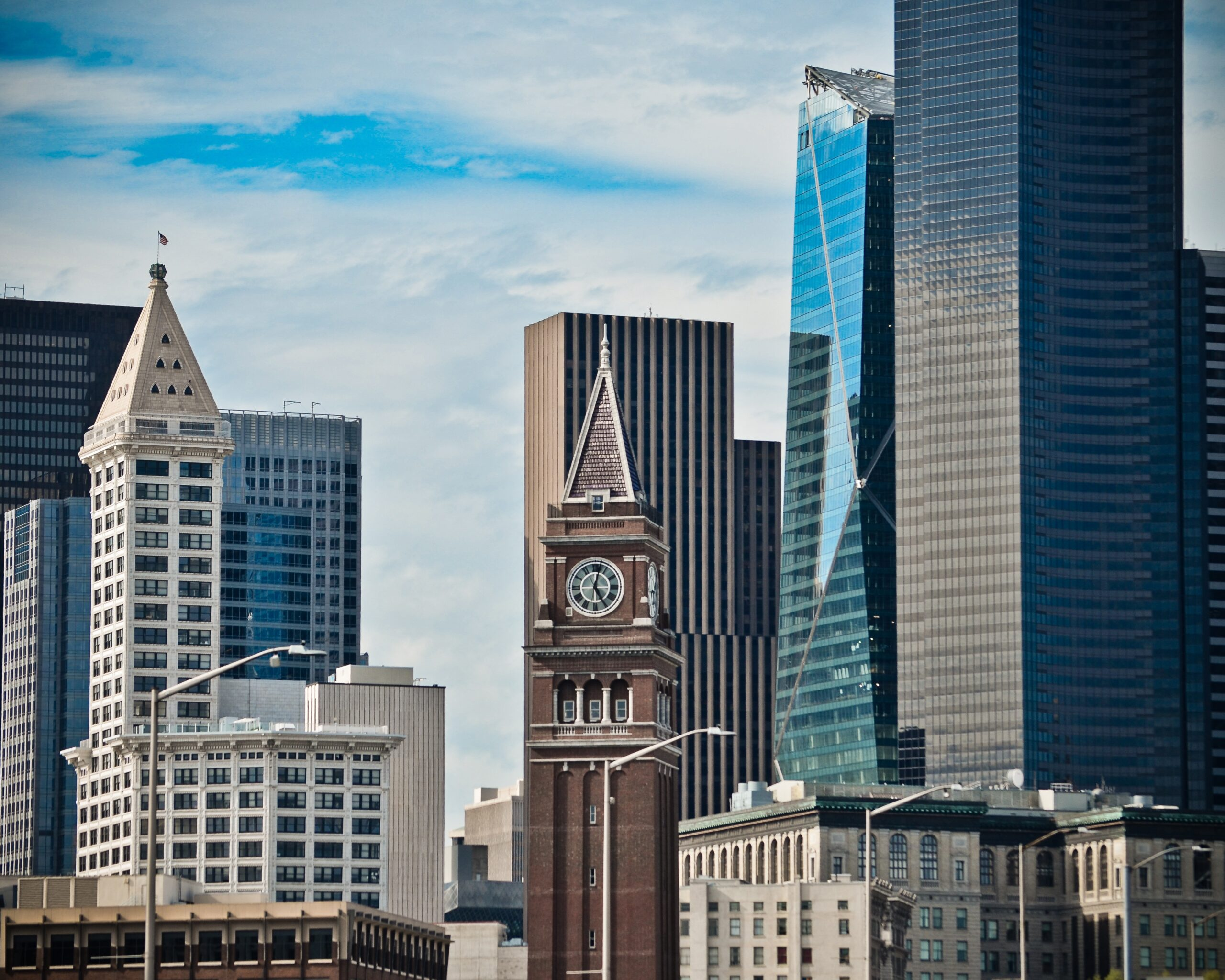 A photo of Seattle buildings in the International District and Pioneer Square, including Smith Tower and the clock tower at King Street Station.